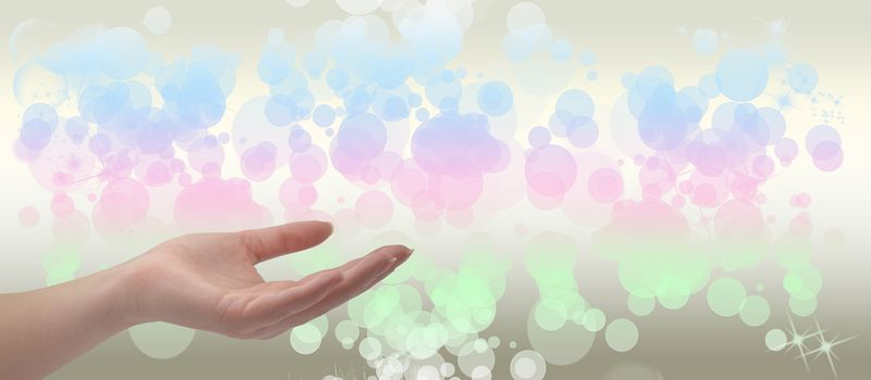 Healing Hand on a sparkling pastel coloured background