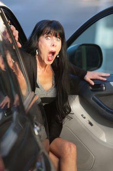 Surprised Woman Leaving a Car
