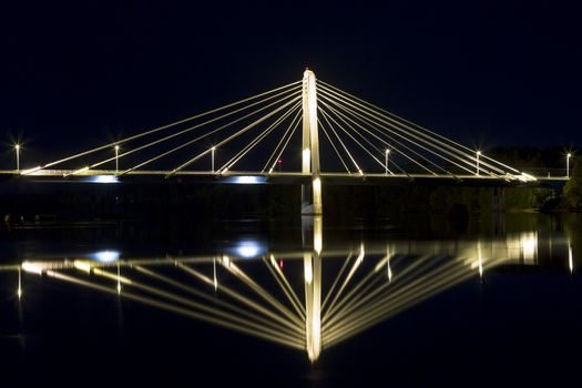 "Cable Bridge in Umeå, Sweden. The ""Kolbäcksbron"" with the river Umeälv in front."