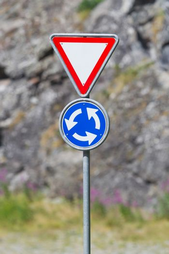 Roundabout crossroad road traffic sign, blue