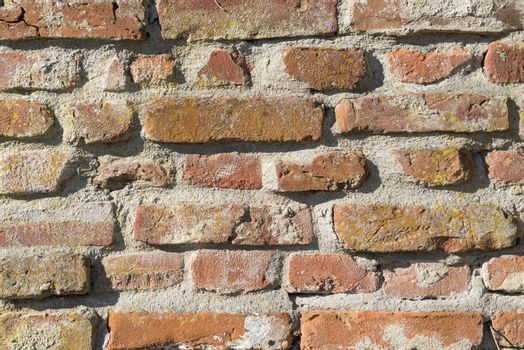 Background, old masonry brick wall in Winterswijk in the Netherlands