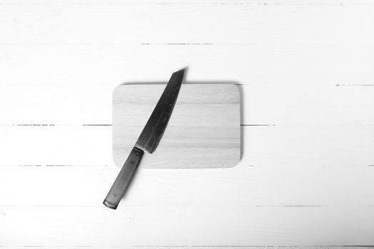 knife and cutting board black and white tone