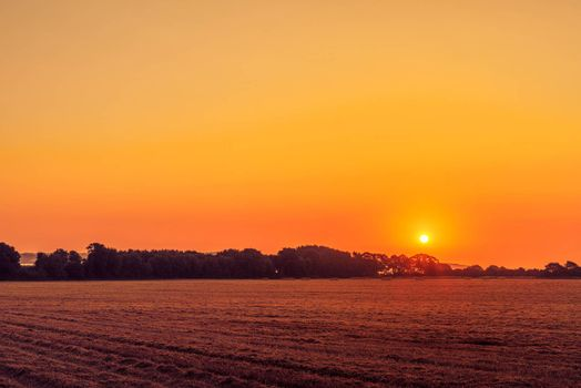 Beautiful sunrise in a countryside landscape an early morning