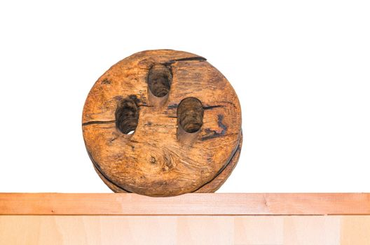 Old antique wooden pulley with pulley.