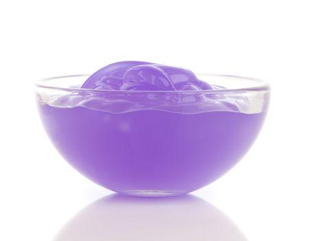 purple cosmetic cream on white background