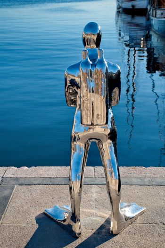 OSLO - MARCH 21: Contemporary scuplture of a diverr in Oslo harbour