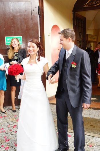 POZNAN, POLAND - SEPTEMBER 22, 2012: Man and woman in front of church after wedding ceremony