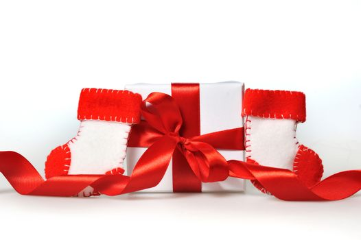 beautiful gift boxes with red ribbons on a white background