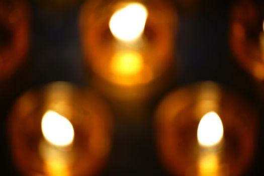 The closeup and top view of blurred Prayer candles.