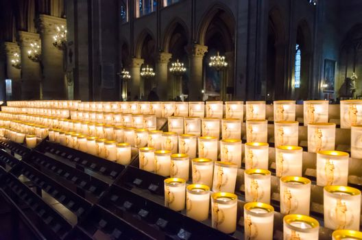 Church candles in Notre Dame Cathedral