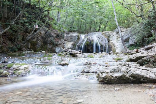 beautiful forest falls in mountains in the summer afternoon, the Crimea, Russia