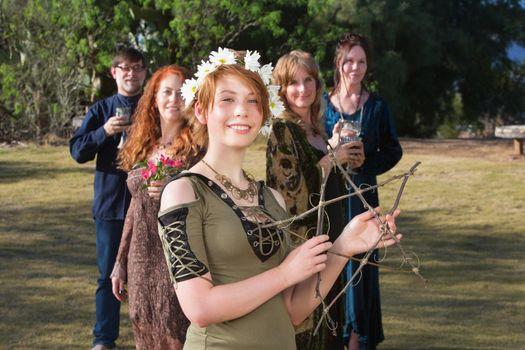Woman Holding a Stick Pentagram