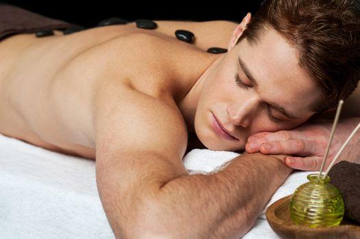 Man relaxing at spa.