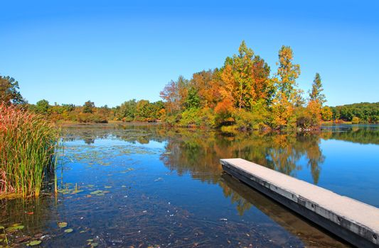 Autumn lake with boat access