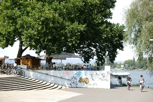 Mainz, Germany - August 22, 2015: The bank of the Rhine promenade on the terraces of Fort Malakoff with a beer garden, and guests on August 22, 2015 in Mainz.
