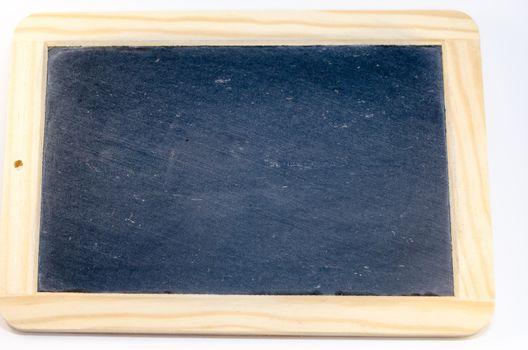 Naked black chalkboard with wooden frame against white background.