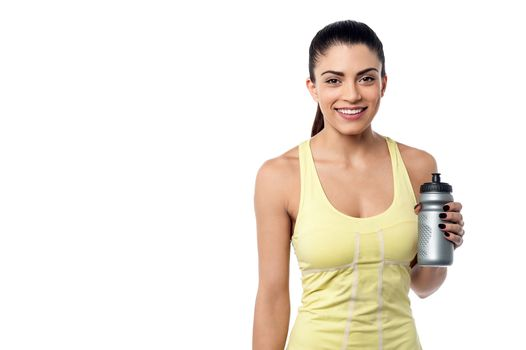 Fit woman holding sipper bottle