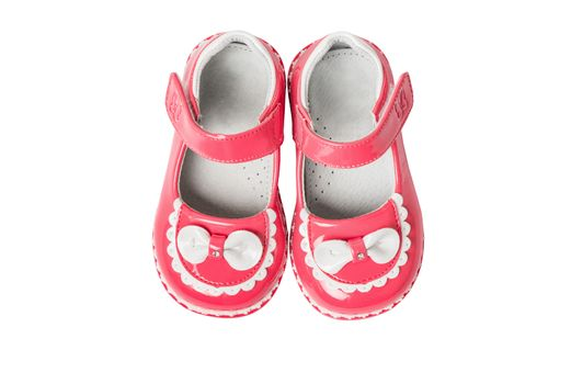 Pink baby girl summer sandals with white bows isolated on a white background,  closeup, top view,