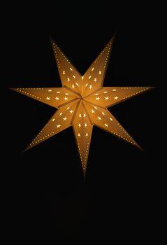 Christmas star isolated on black.