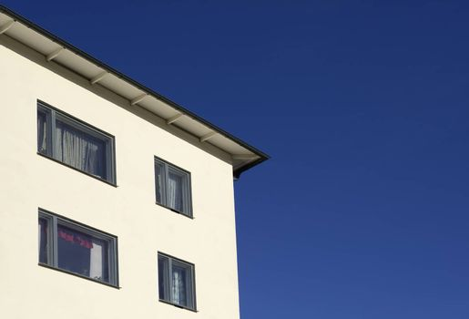 Detail of a modern building with blue sky.