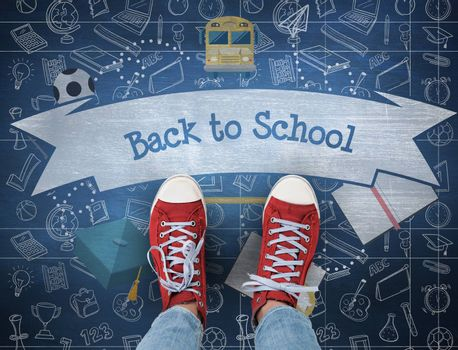 The word back to school and casual shoes against blue chalkboard