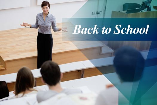 Back to school against teacher standing talking to the students