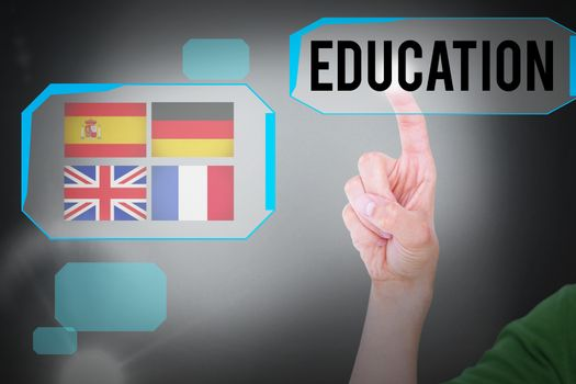 The word education and close up view of man pointing something  against grey background
