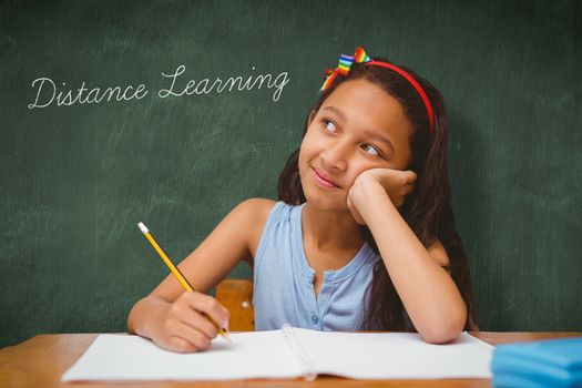 Distance learning against green chalkboard