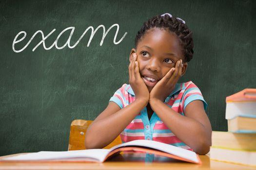 Exam against green chalkboard