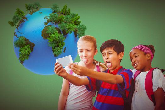 School kids taking selfie in school corridor against green