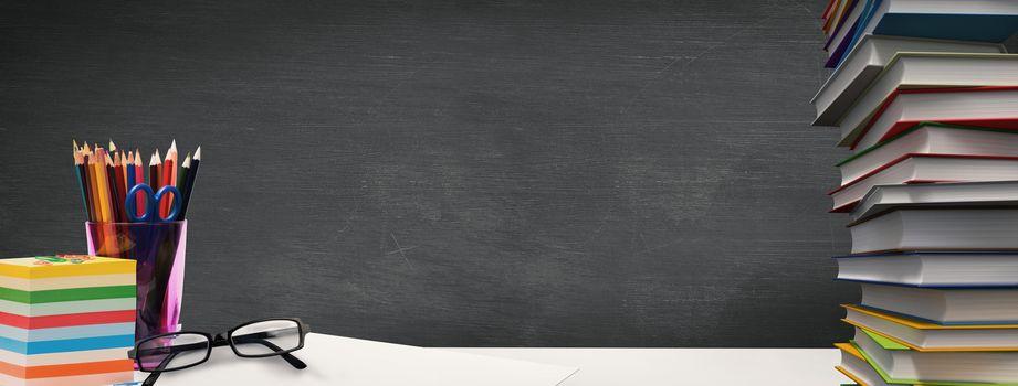 Students desk against black background