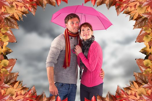Couple standing underneath an umbrella against blue sky with clouds