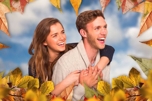 Cheerful young couple embracing against blue sky with white clouds