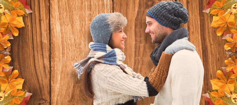 Young winter couple against wooden table