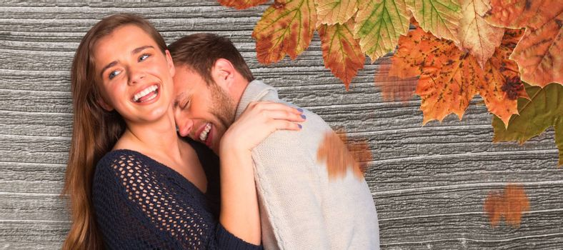 Close up of happy young couple against digitally generated grey wooden plank