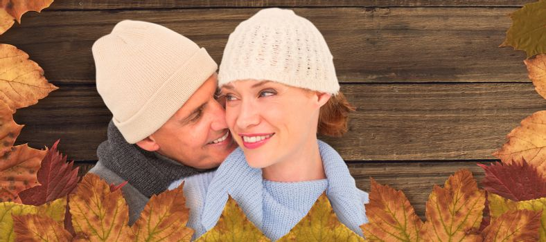 Composite image of casual couple in warm clothing