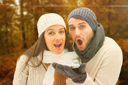 Young winter couple against autumn scene