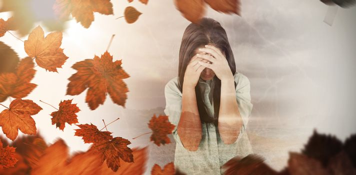 Composite image of troubled woman crying