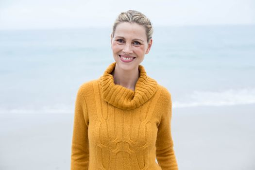 Smiling woman standing in front of the sea