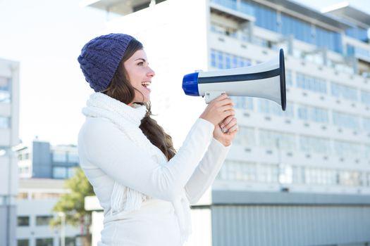 Pretty brunette speaking thought loudspeaker