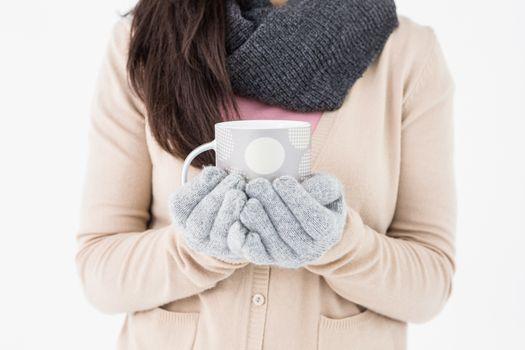 Woman holding polka dotted mug