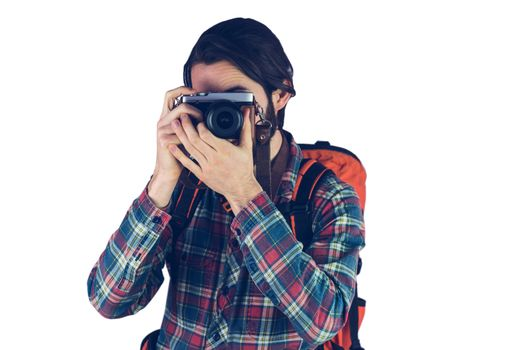 Bearded man taking a photograph