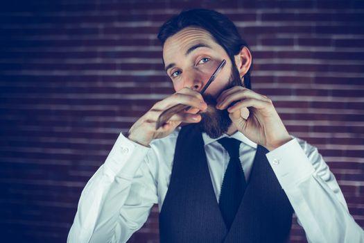 Portrait of man shaving beard