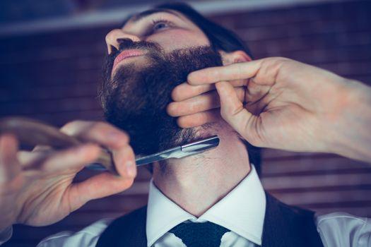 Hipster shaving beard