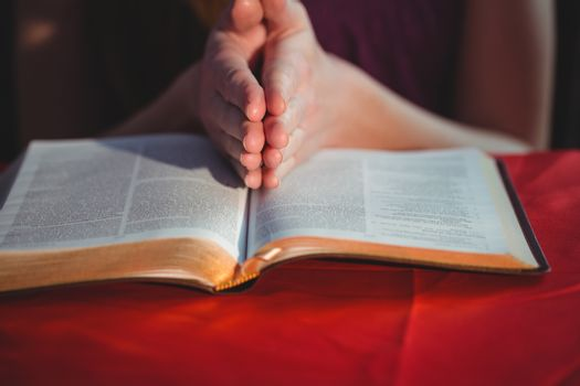 Woman praying with her bible