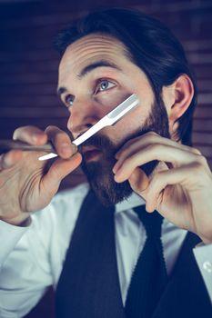 A man shaving his beard