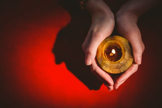 Fortune teller holding a candle