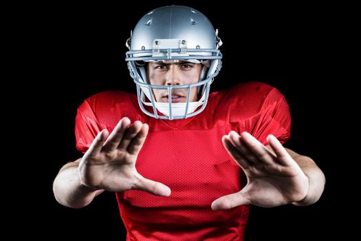 Portrait of American football player defending