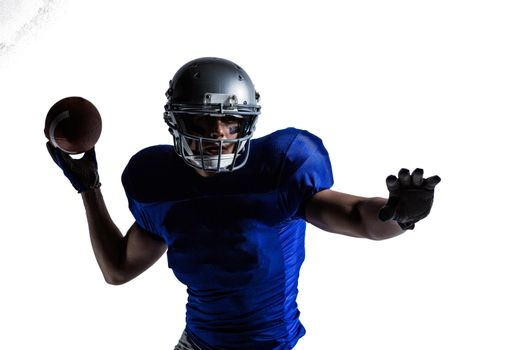 Sportsman throwing football
