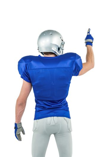 Rear view of sports player pointing